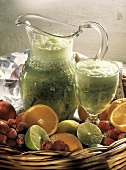 Kiwi Smoothie in a Pitcher and Glass; Fresh Fruit