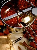 Redcurrants in pureeing pan, sugar, cinnamon & vanilla pod