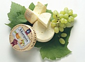 Marquis (Danish soft cheese) with grapes & vine leaves