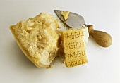 A piece of Parmigiano Reggiano with Parmesan knife