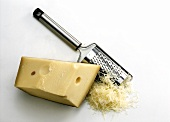 Emmental cheese in a piece & grated with cheese grater