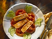 Salmon on tomato & ginger confit with lime slices
