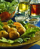 Deep-fried stockfish balls on salad leaves