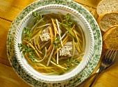 Catfish in wine stock with vegetables, horseradish, parsley