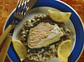 Salmon, pike-perch & spinach strudel with lentils & lemon