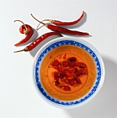 Bowl of chili sauce and dried chili peppers