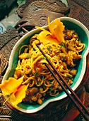 Noodles in fish sauce with carrot butterflies