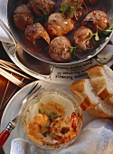 Snails in red wine sauce and baked eggs with shrimps