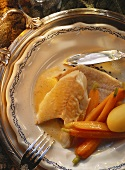 Pike with butter sauce, halved carrots and boiled potatoes