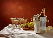 Four Glasses of Champagne; Champagne Bottle in Ice Bucket