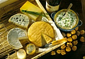 Various types of French cheese & several walnuts