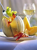 Melon halves stuffed with freshwater crayfish & celery