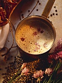 Cream and bacon sauce with chive flowers