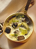 White wine sauce with strips of leek and truffles