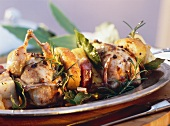 Quail with bacon, celery, white bread, herbs on skewer