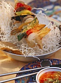 Fried vegetable kebab on Asian noodles and vinegar dip