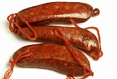 Three chorizo (air-dried Spanish sausages)
