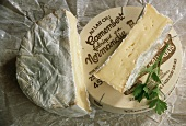 Camembert, cut into, on wrappings