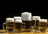 Various full beer tankards on beer table
