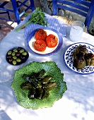 Stuffed vine leaves, stuffed tomatoes, pepper, olives