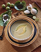 Avocado cream soup with avocado slices and clams