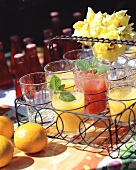 Refreshing drinks with orange juice & Campari in wire basket