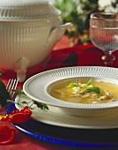 Brodo di pollo (chicken broth with pasta envelopes, Italy)