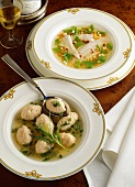 Turbot soup with vegetables & salmon dumplings in herb broth