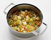 Making potato soup (diced potato and vegetables in pan)