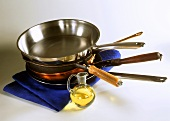 Various frying pans and a small pot of oil