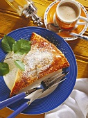 Pear turnover with icing sugar and a cup of coffee