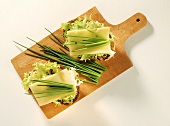 Wholemeal bread topped with lettuce, cheese and chives