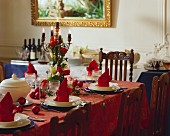 Festive table with red napkins, candlesticks