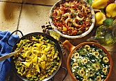 Rice dishes with green vegetables, tomatoes, saffron