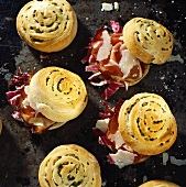 Filled radicchio rolls with ham and Parmesan shavings