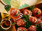 Tomatoes stuffed with couscous with spinach & grated cheese