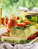 Vegetable terrine garnished with garden cress & tomatoes