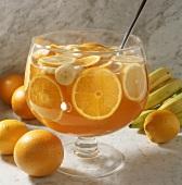 Orange punch with orange slices, lemons & bananas