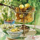 Potato fondue with herb dip and salads