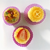 Strawberry sweet and candied fruit in paper cases