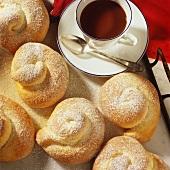 Spanish esmenaldas (yeast pastries) with icing sugar & coffee