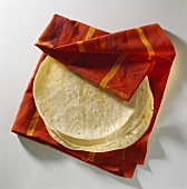 Thin baked flat breads on napkin