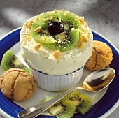 Ice cream souffle with kiwi slices, red grapes & biscuits