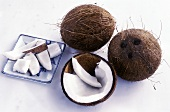 Whole coconuts and coconut pieces
