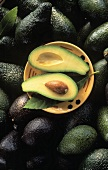 Avocados, plate with two avocado halves on top