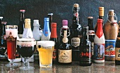 Various types of Belgian beer in bottles & glasses