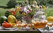 Melon punch, melons & flowers on summer garden buffet