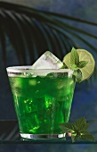 Drink: Green Devil with gin, mint, ice cubes & lime slice