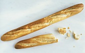 Whole & half baguette and a few broken pieces of bread