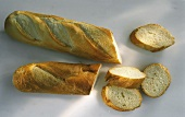 Cut white bread and baguette and slices of bread
